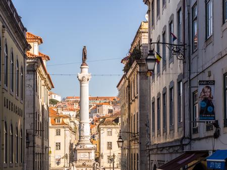 LISBON, PORTUGAL - JANUARY 10, 2017: Column of Pedro IV on Rossio Square (Pedro IV Square) in Lisbon, Portugal, seen from Calcada do Carmo street.