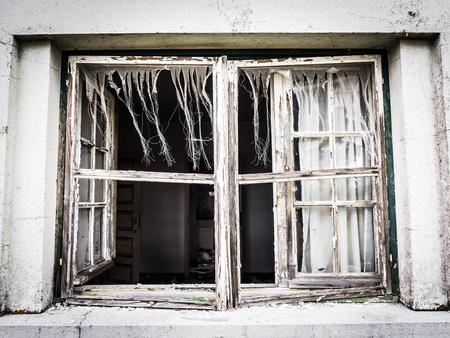 Window of an abandoned house in Alentejo region, Portugal.