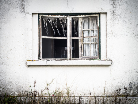 Window of an abandoned house in a village in Alentejo, Portugal Stock Photo