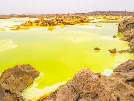 Sulphur lake Dallol in a volcanic explosion crater in the Danakil Depression, northeast of the Erta Ale Range in Ethiopia. The lake with its sulphur springs is the hottest place on Earth. Stock fotó - 76917886