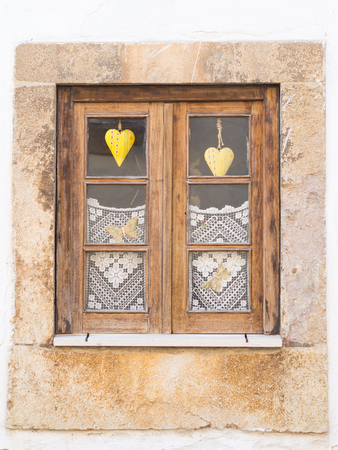close uo: Old wooden window in Portugal.