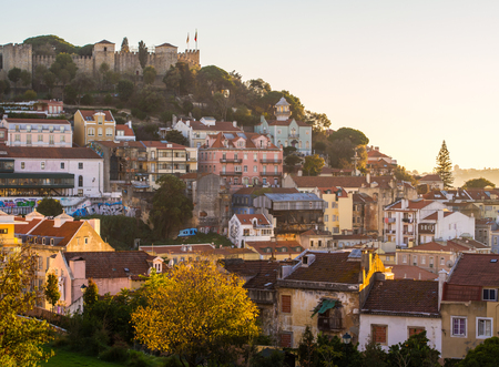 Sao Jorge Castle in Lisbon, Portugal, with the sourrounding architecture, at sunset. Editorial