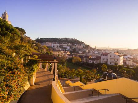 LISBON, PORTUGAL - NOVEMBER 19, 2017: Jardim da Cerca da Graca in Lisbon, Portugal, at sunset. Sao Jorge castle in the background.
