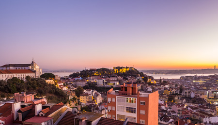 LISBON, PORTUGAL - NOVEMBER 19, 2017: The cityscape of Lisbon, Portugal, by night, shortly after sunset on a November day. Editorial