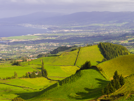 Landscape in Sao Miguel Island, Azores, Portugal, as seen from Coal Peak viewpoint. Capelas in the background