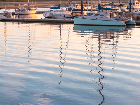 OLHAO, PORTUGAL - MARCH 28, 2018: Port in Olhao, Algarve region in south of Portugal, at sunset.