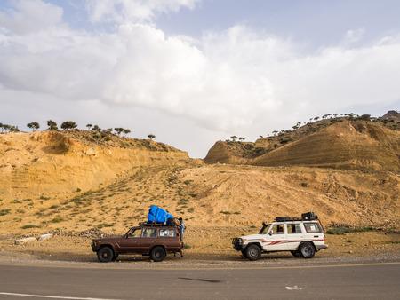 DANAKIL DEPRESSION, ETHIOPIA - JUNE 29, 2016: People traveling in jeeps in Danakil Depression, Ethiopia, the hottest place on Earth.