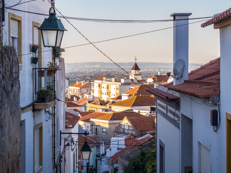 Street in the Old Town in Palmela, Setubal District, south of Lisbon in Portugal, at sunset.