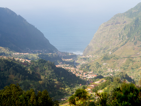 View of a valley in Madeira island, Portugal, with the Atlantic Ocean in the background. Stock fotó