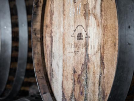 Setubal, Portugal - February 02, 2018: Wooden wine barrels in Quinta do Piloto, Setubal wine region, Portugal.