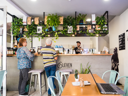 Madeira, Portugal - October 31, 2018: People at Legs Eleven coffee shop  in Funchal, the capital of Madeira, Portugal