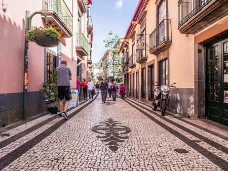 Madeira, Portugal - October 31, 2018: Street in the historical part of Funchal, the capital of Madeira, Portugal. Sajtókép