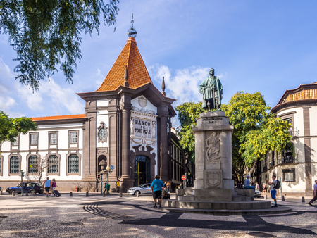 Madeira, Portugal - October 31, 2018: Monument of Joao Goncalves Zarco and the bilding of Banco de Portugal in Funchal, the capital of Madeira, Portugal.