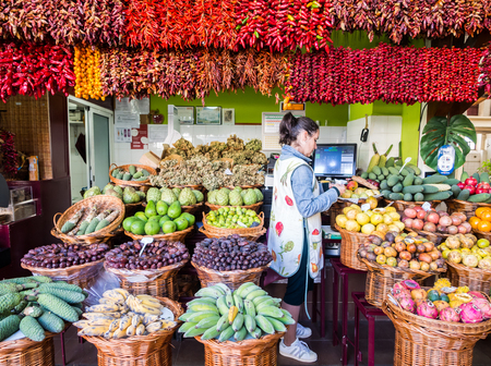 Madeira, Portugal - October 31, 2018: Stand in Mercado dos Lavradores, a local market in Funchal, the capital of Madeira island, Portugal.