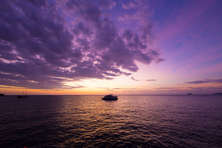 Floating boat with sunset