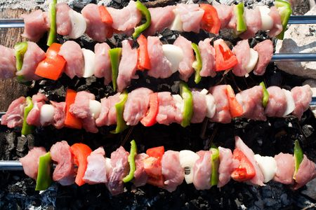 broach: Barbecue with raw meat skewers. Barbecue with delicious grilled meat on grill