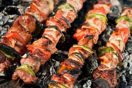 Barbecue with meat skewers. Barbecue with delicious grilled meat on grill photo