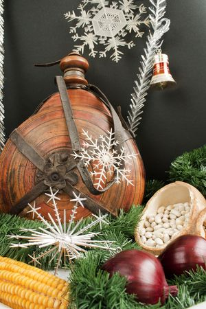 dried gourd: Christmas decoration with gift box, snowflakes, small keg, garland, onion, corn and haricot beans isolated on black background Stock Photo