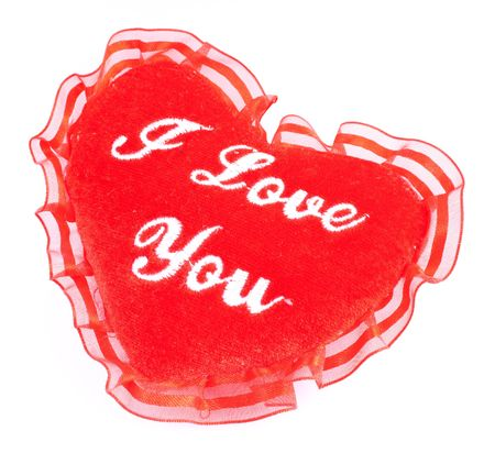 Valentine heart - soft pillow with I love you embroidering. Valentines Day heart shaped pillow. Fluffy soft red heart. photo
