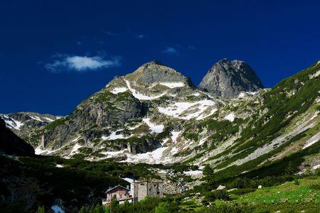 Mountainous landscape - Rila mountain in Bulgaria. Mountinious landscape with green ecological nature. photo