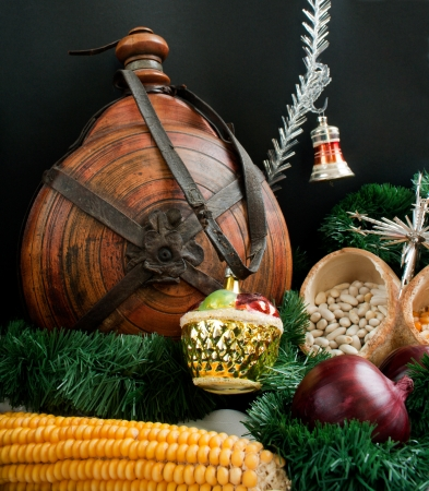 Christmas decoration with snowflakes, keg, garland, onion, corn photo
