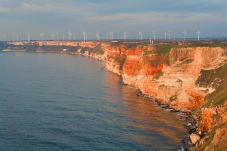skie: Summer beach on Bulgarian Black sea  Wind power generators