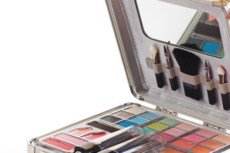 Multicolored eye shadows with cosmetics brush. Eyeshadow makeup palette. Colorful eye shadow make up. photo