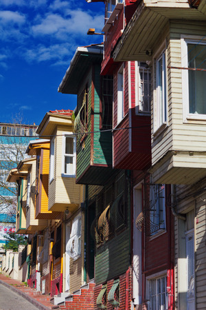 fatih: Colorful street scene with very narrow house painted  Historic houses in Istanbul, Fatich