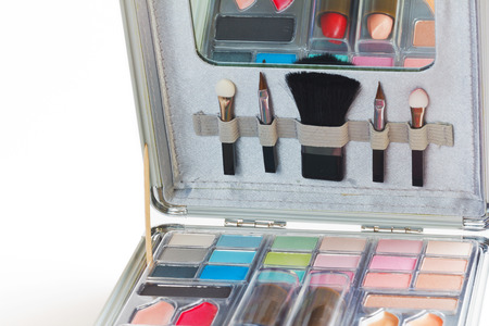 cosmetologist: Multicolored eye shadows with cosmetics brush  Eyeshadow makeup palette  Colorful eye shadow make up