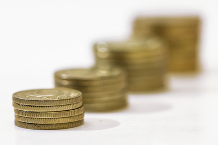 richer: Money growth concept, where small coins in a pile gets bigger and higher for each pile. Stock Photo