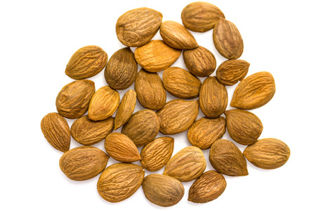 kernel: Apricot kernel  nuts isolated on white background. Stock Photo