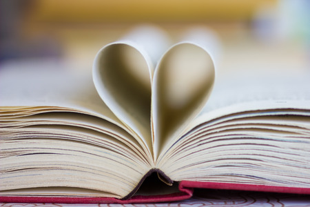 Opened book with heart shaped pages