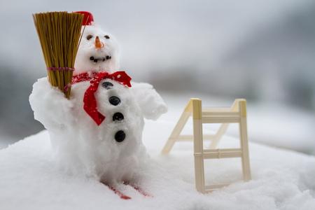 Snowman standing in winter landscape