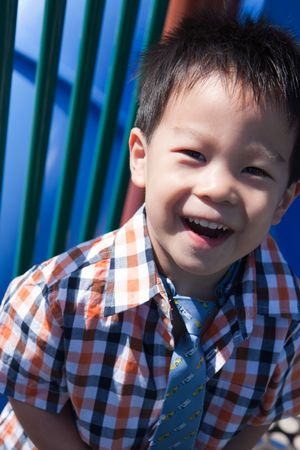 a young boy is laughing Stock Photo