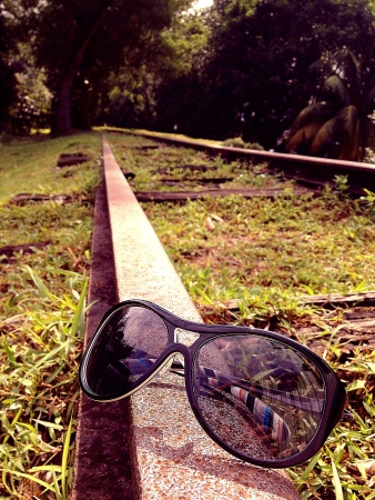 Sunglasses on an old train track