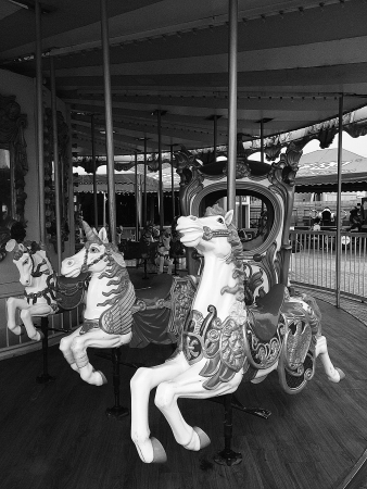 Merry go round at the amusement park Stock Photo
