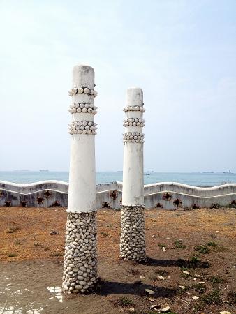 Unique pole design by the sea Stock Photo