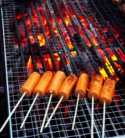 Barbeque with sticks of sausages Stock Photo
