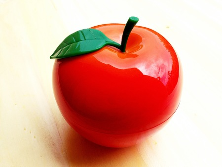 Bright colour apple on a wooden table Stock Photo