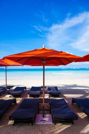 Beach Umbrella with lounge chairs Stock Photo - 23216261