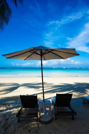 Beach Umbrella with lounge chairs Stock Photo - 23216271
