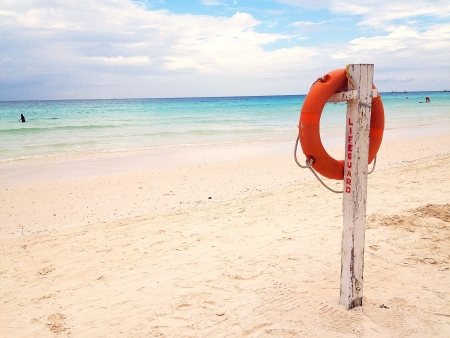 Lifebuoy by the beach Stock Photo - 23216276