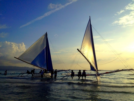 Sail boat by the sea at sunset Stock Photo