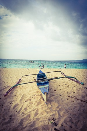 Wooden boat by the beach