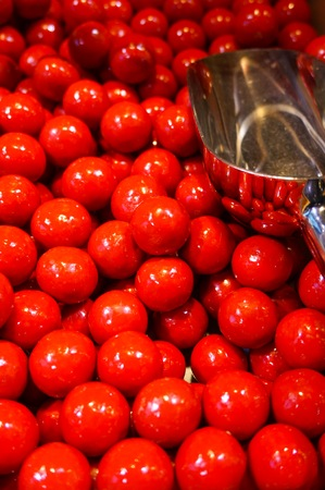 Red colour sweets with metal scoop                               Stock Photo