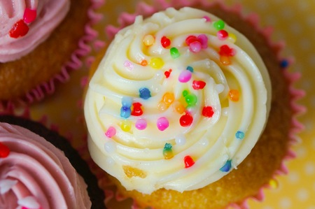 Cupcakes with yellow polka dot background Stock Photo