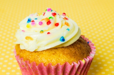 Cupcake with yellow polka dot background