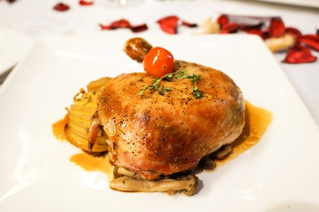 Roasted chicken with potatoes and mushrooms