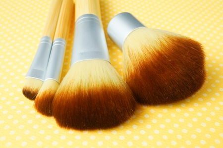 Brushes in a yellow background Stock Photo