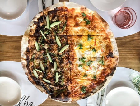 Pizza with different flavors Stock Photo